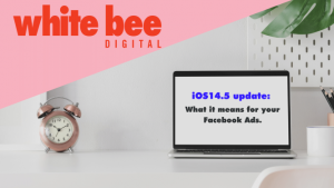 Laptop on a white desk with the text 'ios14.5 update: what it means for your facebook ads' on the screen